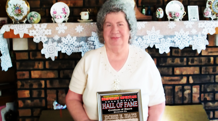 Doris E. Hays holding the Hall Of Fame Award she recently received in the post from Keith Bradford