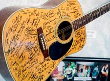Slim Andrews donated a guitar for hall of fame inductees to sign. He left the instrument in the trunk of his car and the temperature dipped to 17 degrees that night and warped the guitar.